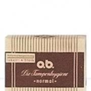 Bilde av en tidligere versjon av o.b. tampong pakke. Gul- og brunfarget med striper.